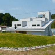 Dormer windows protrude from mono-pitched roof of House in Tokushima