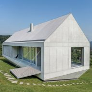 Robert Konieczny uses drawbridge to create ark-like house on a steep Polish hillside