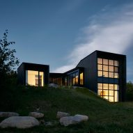 Burnt cedar clads mountainside home in Quebec by Alain Carle