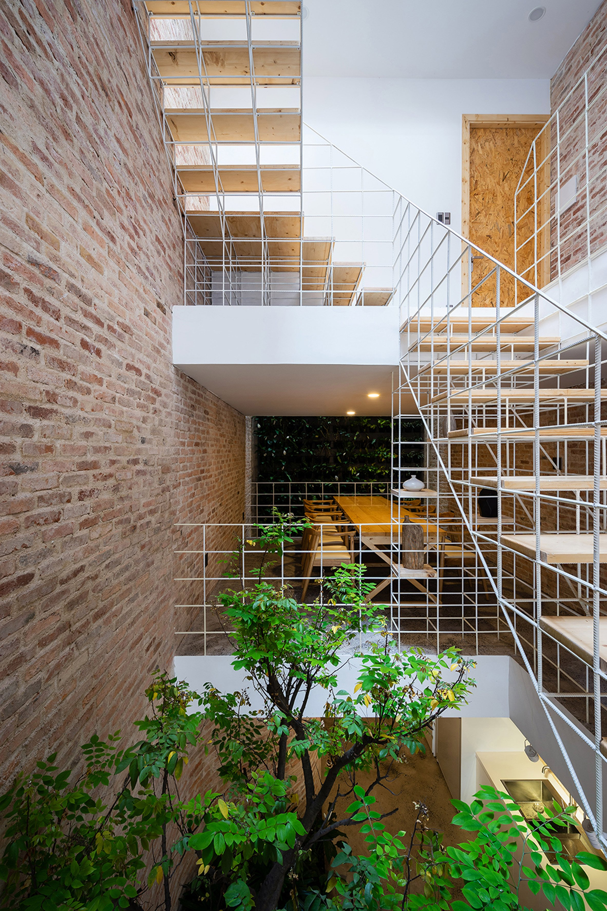 Block Architects adds trellises and steel-bar walls to Vietnamese house