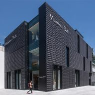 Dark metallic screen covers Massimo Dutti store in Mexico City by SMA