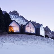 Three blackened wood huts project from mountain restaurant by Peter Pichler and Pavol Mikolajcak