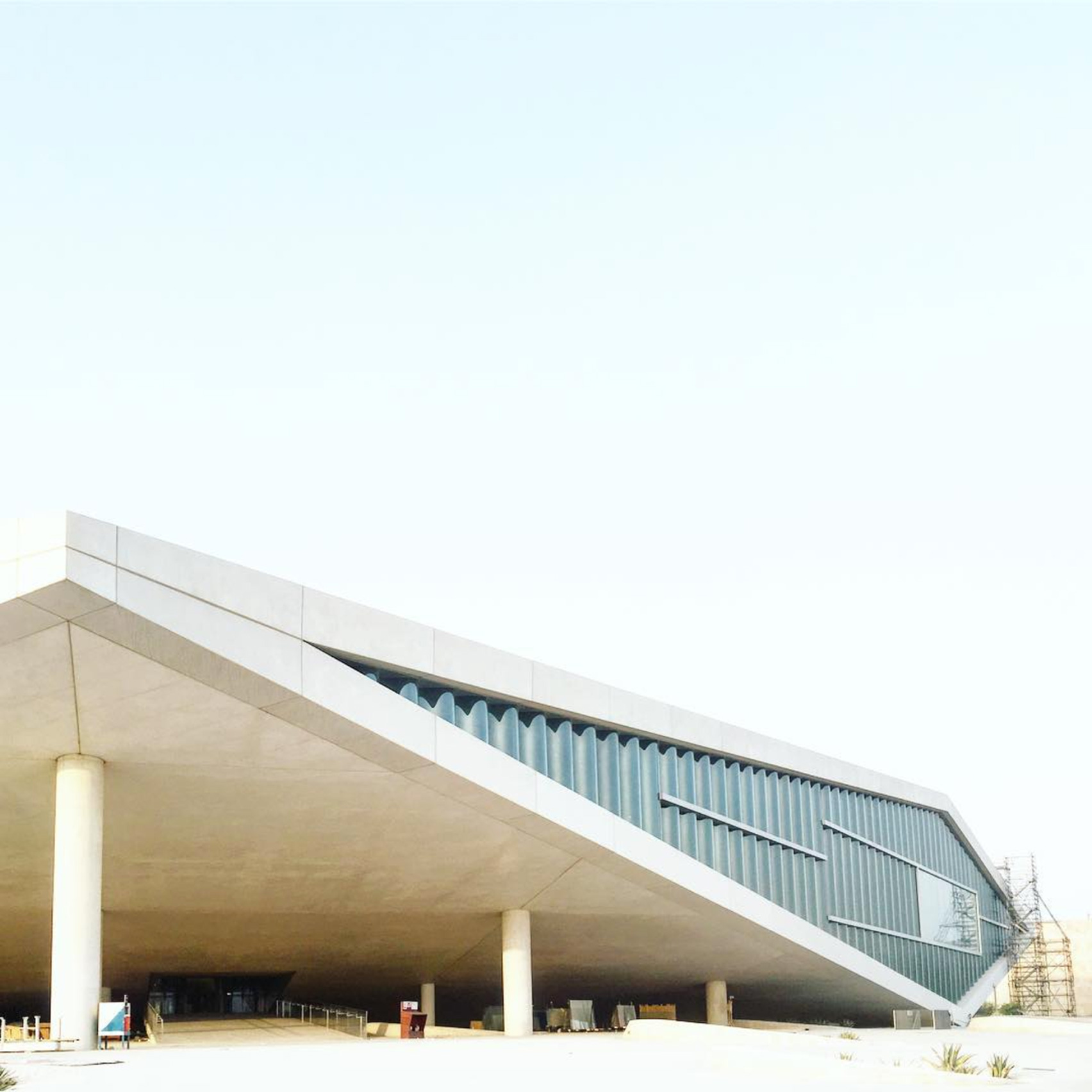 Oma completes industrial style exhibition centre in old for Architecture firms in qatar