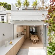 Worktop extends from kitchen to garden in Sydney residence by Benn + Penna Architecture