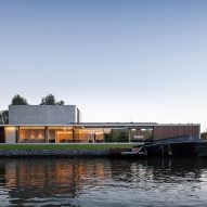 Govaert & Vanhoutte Architects creates bachelor pad with underground club on Ghent's Leie river