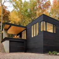 Studio MM clads Hudson Valley hillside cabin in blackened wood