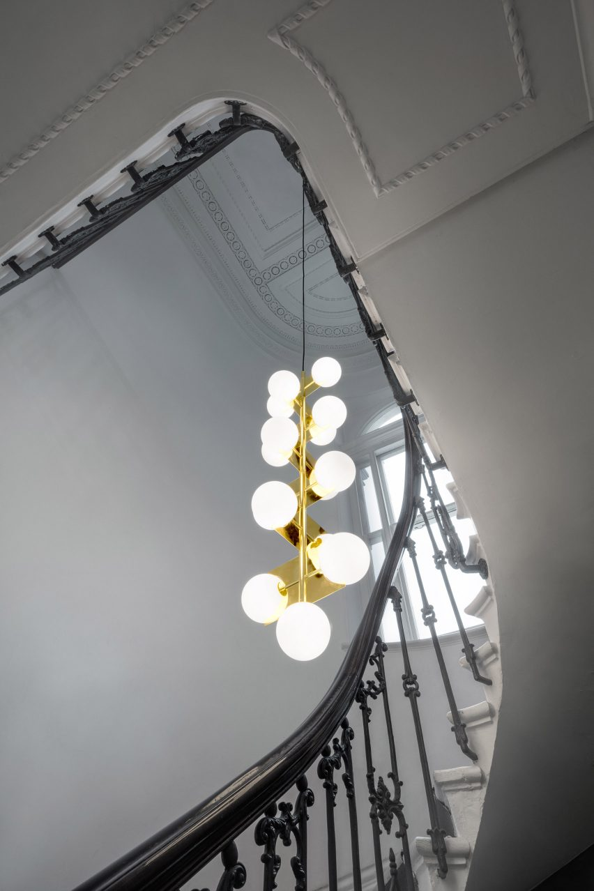 tom lighting. Plane Is A Brass-plated Chandelier That Can Be Rotated Into Different Configurations Tom Lighting