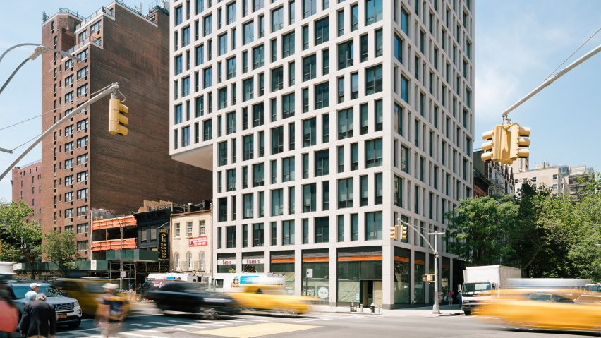 luxury manhattan apartment tower cantilevers over low rise neighbour
