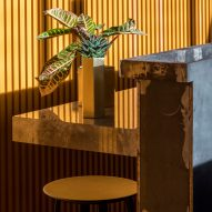 Cement grey meets bright ochre in Grzywinski + Pons' London restaurant interior
