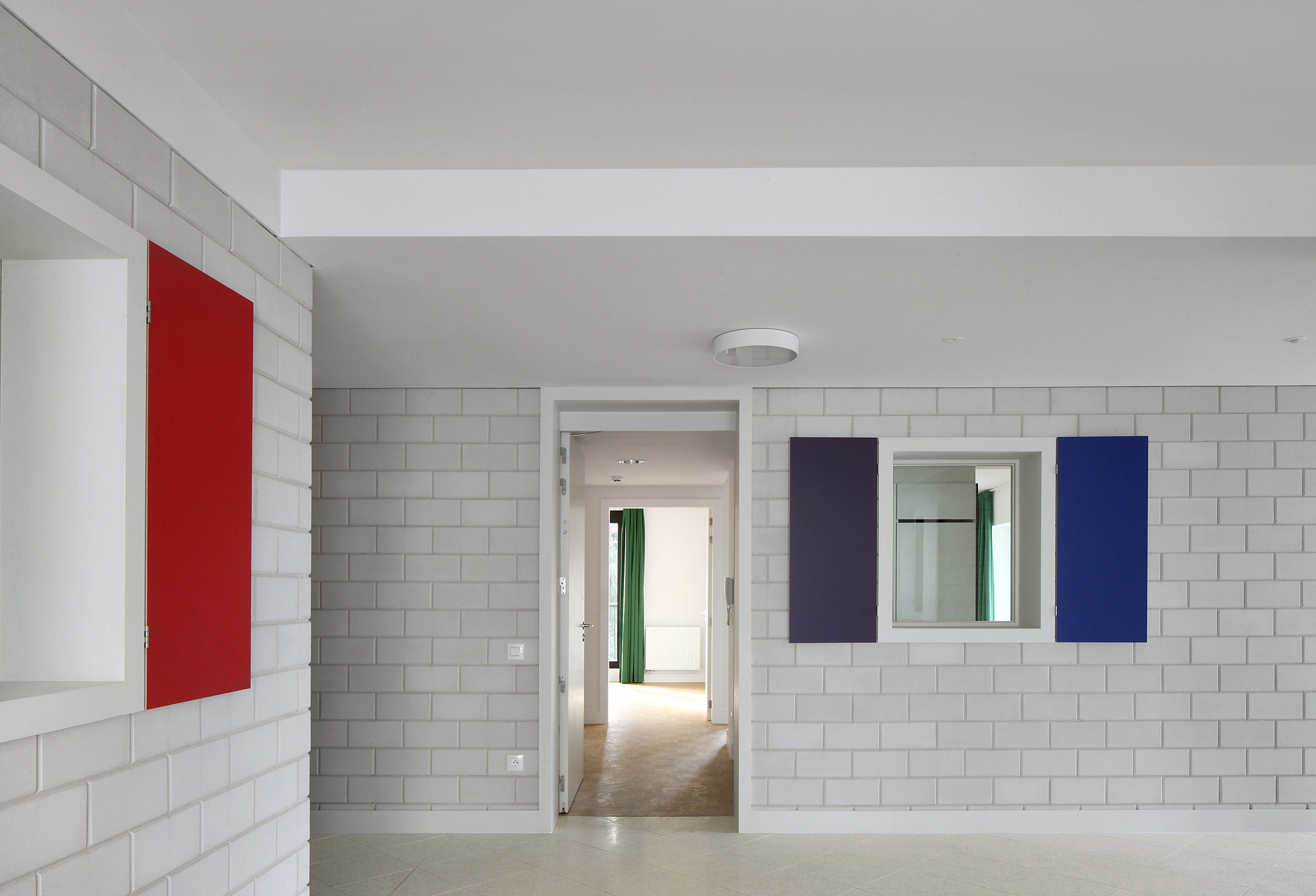 DRDH and adVVT complete elderly home in Belgium featuring pared-back finishes and open-air courtyards