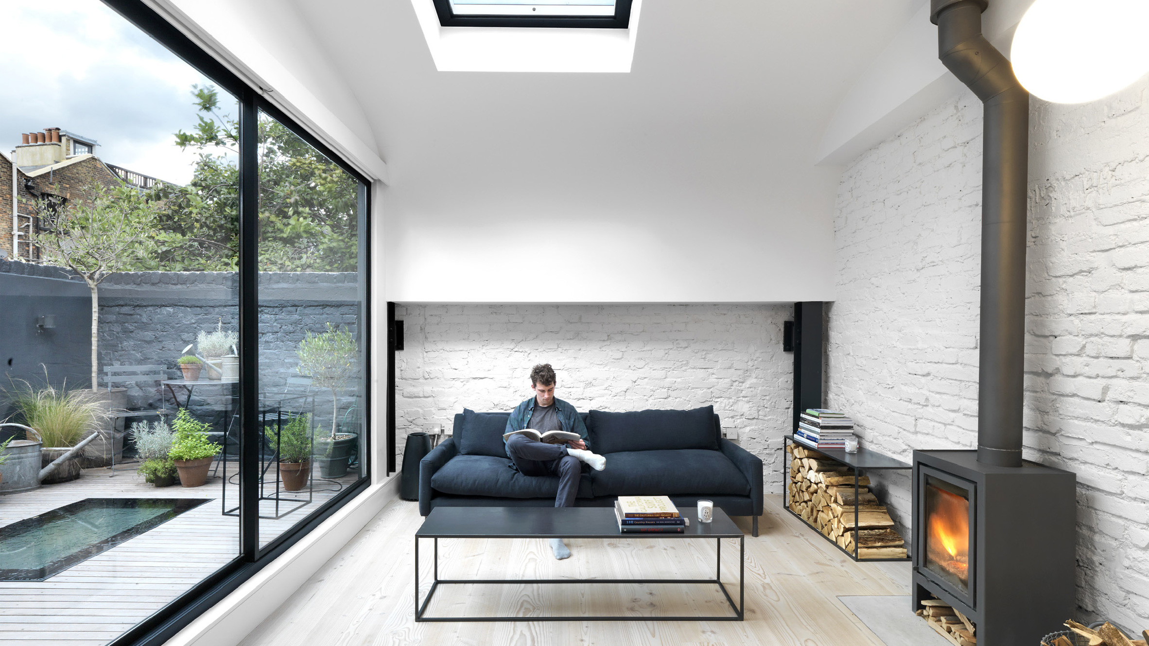 Threefold Architects Updates London Mews House With Monochrome Interiors  And Rustic Details