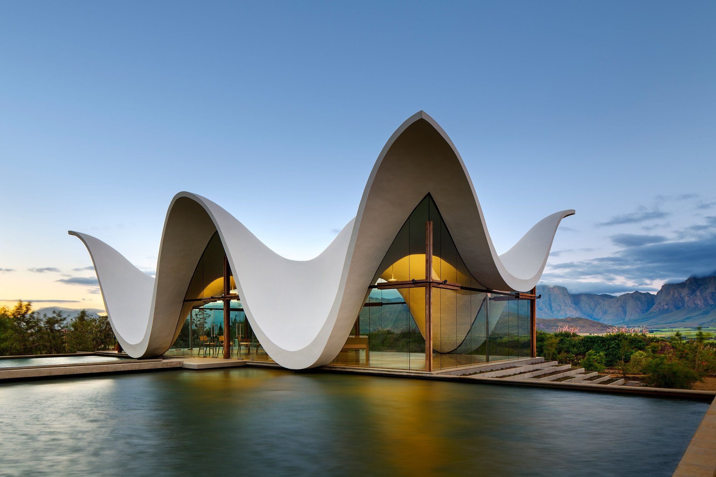 Steyn Studio's chapel frames dramatic views of South African countryside below its sinuous roof