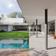 Plant-filled courtyards create natural enclaves in Brazilian home by AMZ Arquitetos