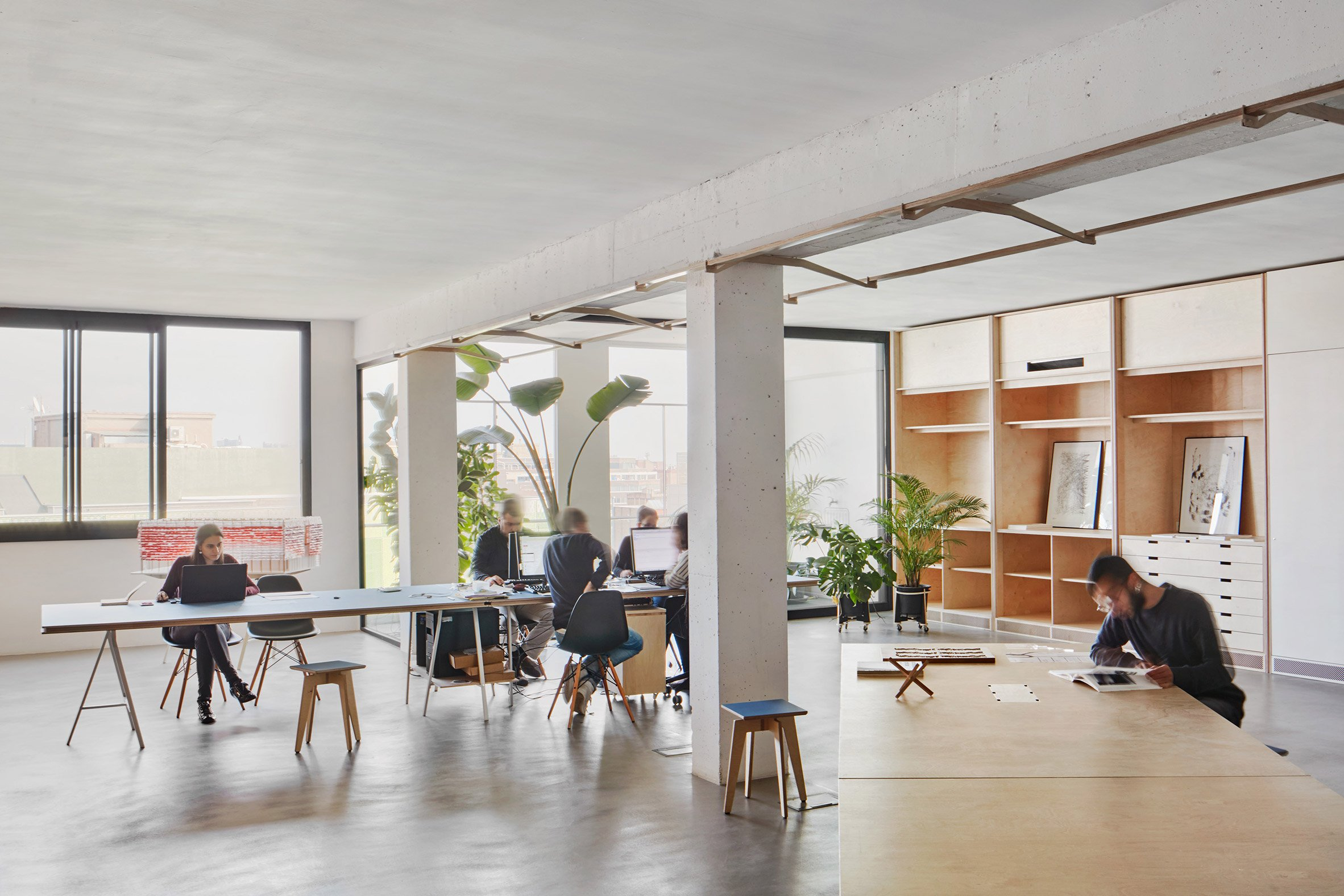 Barcelona warehouse transformed into flexible co-working space for architects and designers