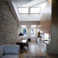 DUA completes contemporary Dublin mews house with sunken concrete bathroom