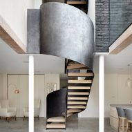 Steel-wrapped staircase winds through Hackney extension by Cousins & Cousins