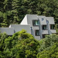 Stone fins cover slanted walls of mountainside house near Seoul
