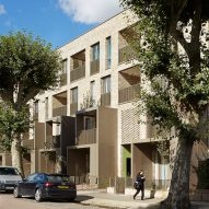 Bronze balconies project from trio of brick housing blocks by Alison Brooks Architects