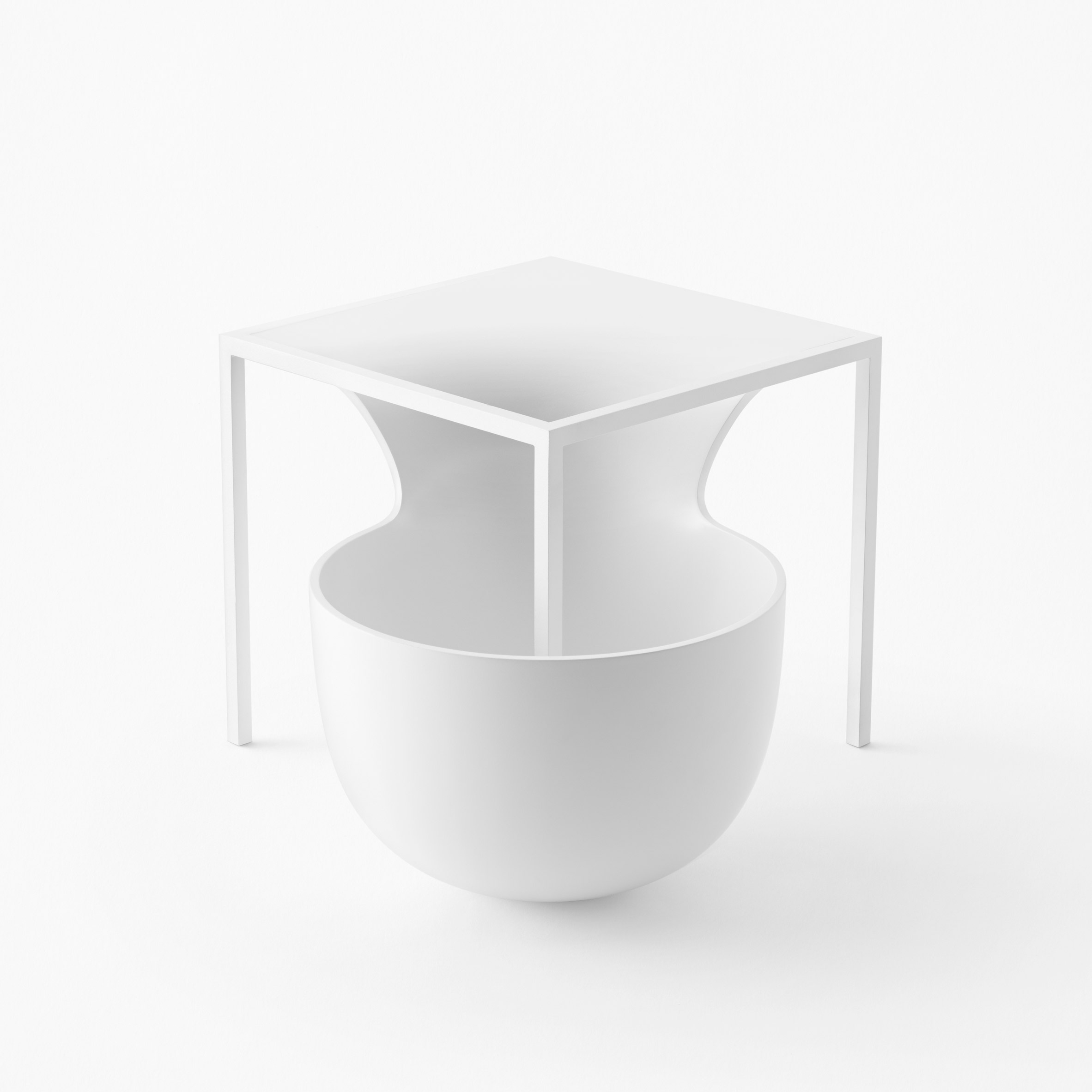 Nendo's Flow furniture collection combines tables with giant bowls