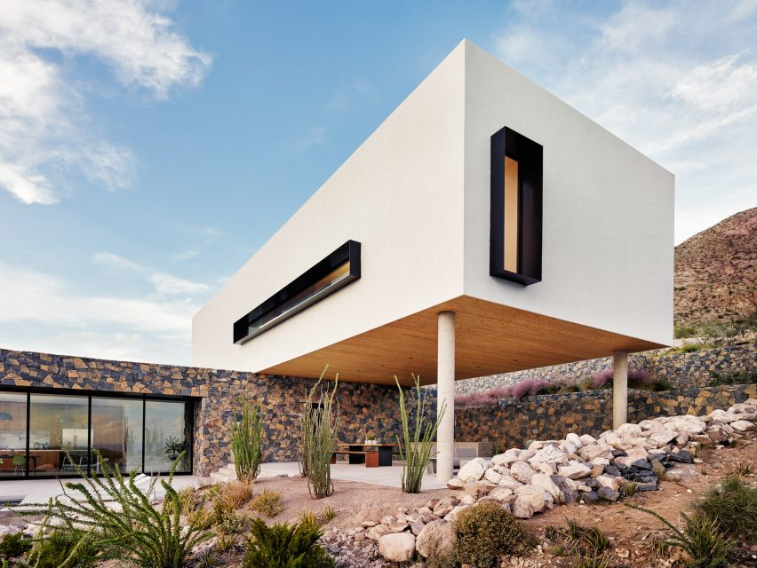 Volcanic Stone Contrasts With White Stucco At Texas Desert Home By