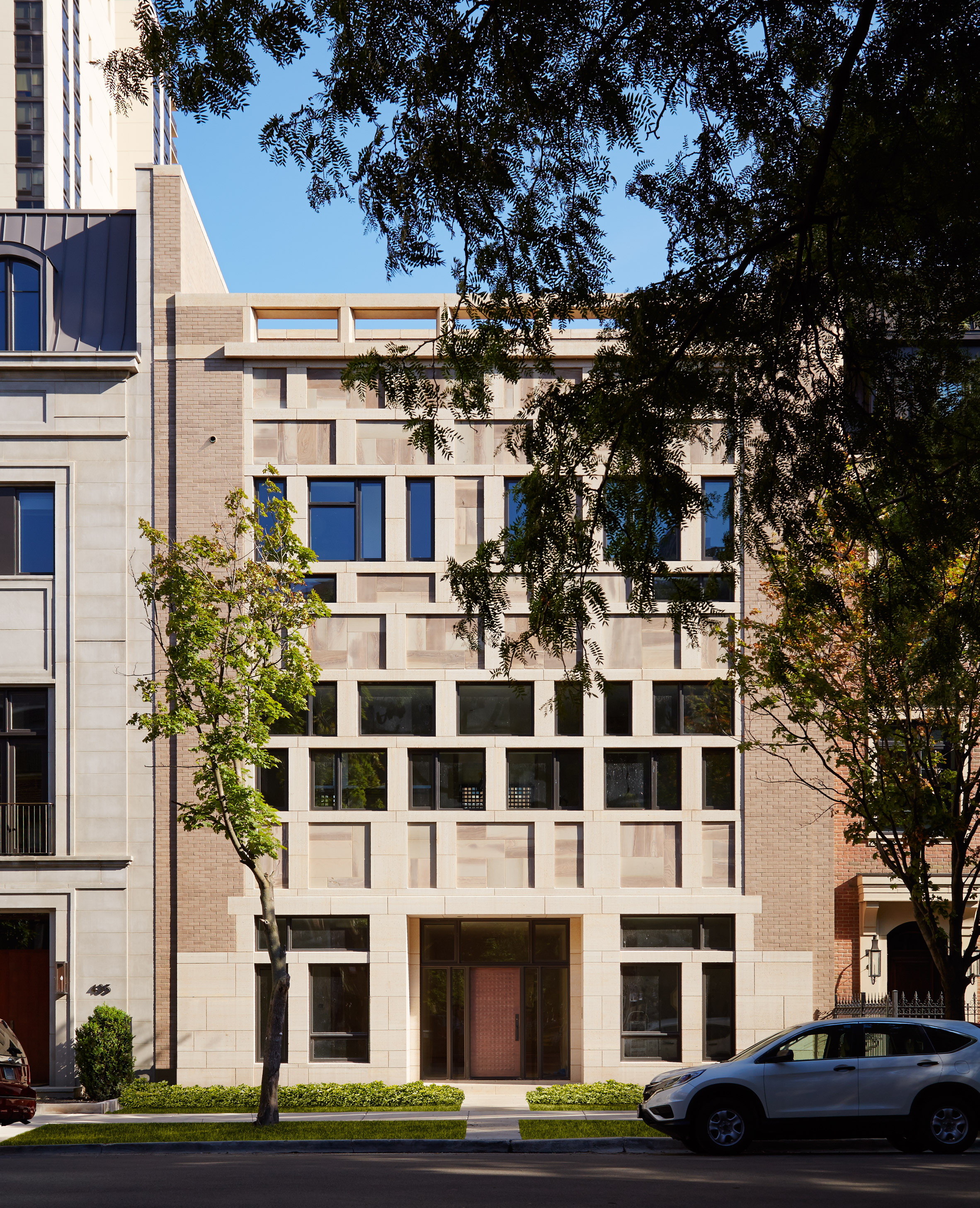 Patchwork of stone, brick and glass fronts Chicago townhouse by HBRA Architects