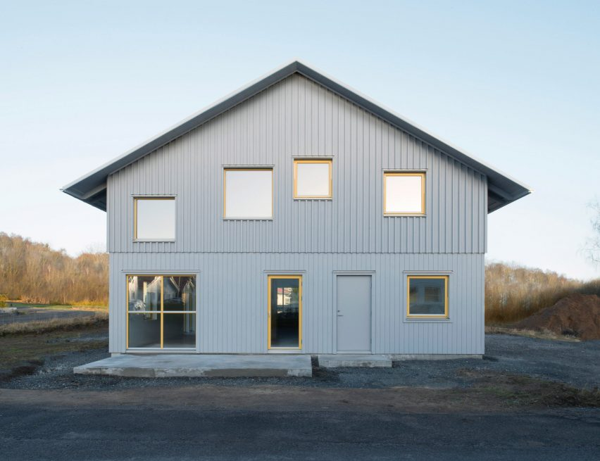 Grey prefab Stockholm house features colourful walls and yellow ...