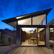 Arii Irie Architects uses angled windows to create tilted roofs for Japanese house extension