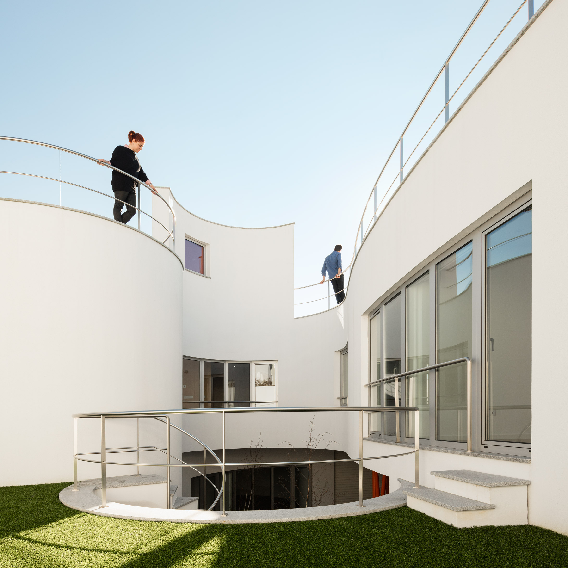 House L27 by dIONISO LAB is arranged around a curving courtyard in northern Portugal