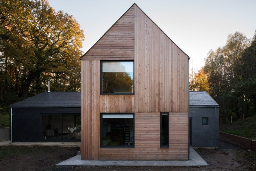 House Architects cross-shaped houseelliott architects stands in english woodland