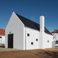 ADR places small white fruit distillery among 19th-century farm buildings in Bohemia