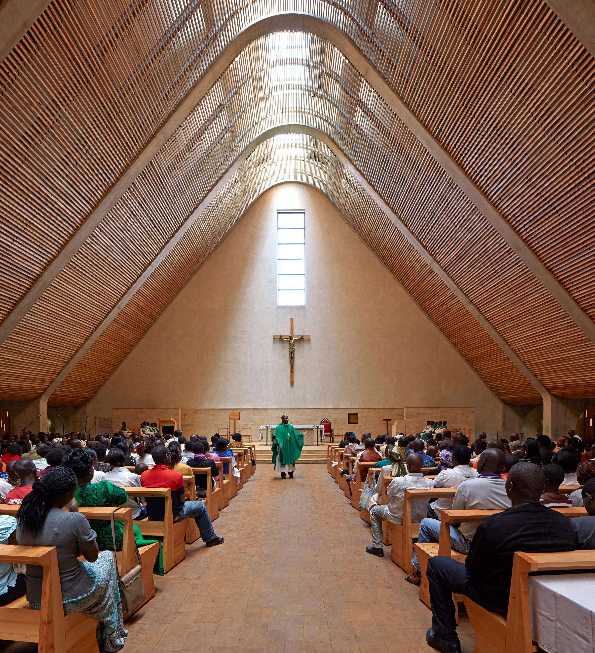 Huge inclined roof spans cathedral built by John McAslan + Partners on Kenyan tea plantation
