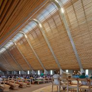 Huge inclined roof spans cathedral built by John McAslan + Partners on Kenyan tea plantation