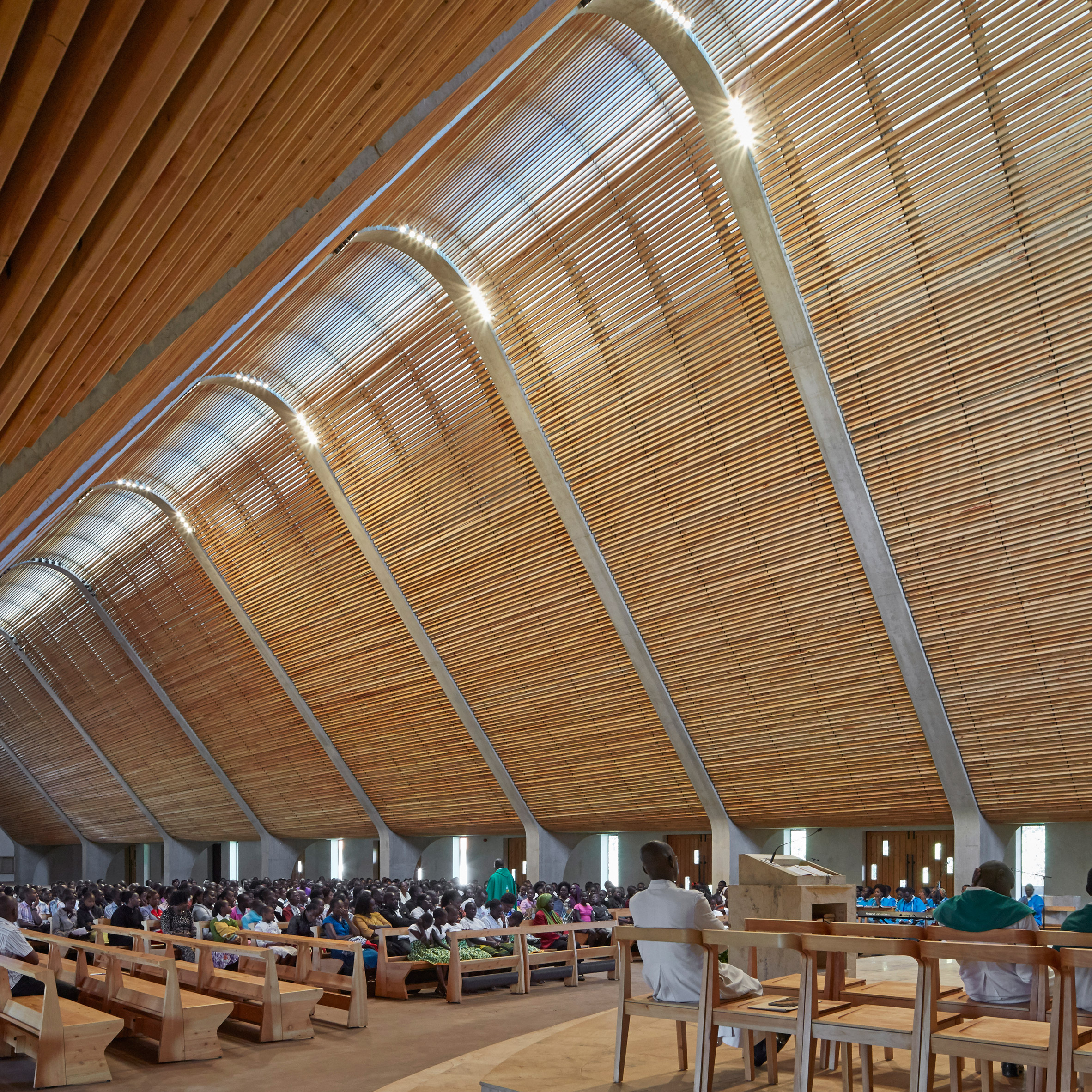 Huge inclined roof spans john mcaslans cathedral on kenyan tea plantation