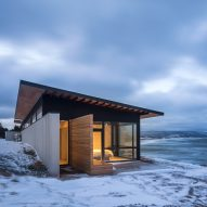 Omar Gandhi Architect perches glass-walled cabin on rocky cliff in Nova Scotia