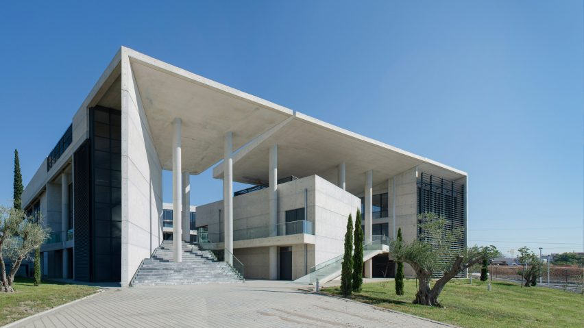 Angled Walls And Fissures Break Up Mass Of Concrete Office Building By  Vtria Architects