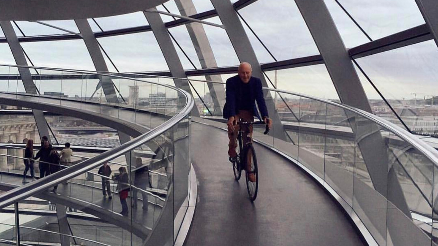 Norman Foster cycling around the Reichstag dome