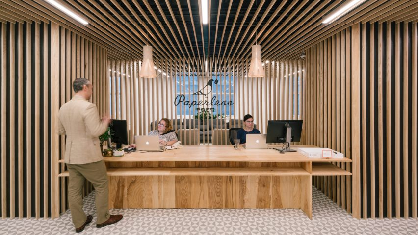 Wooden slats surround reception at Paperless Posts Manhattan
