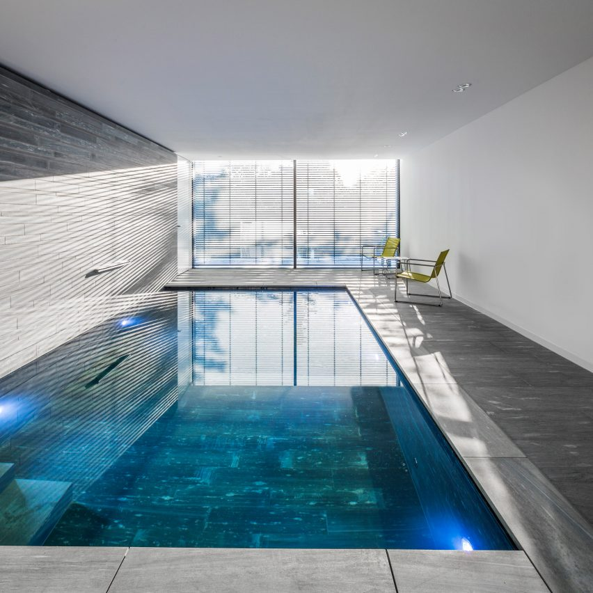 stone lined swimming pool in cologne house features large