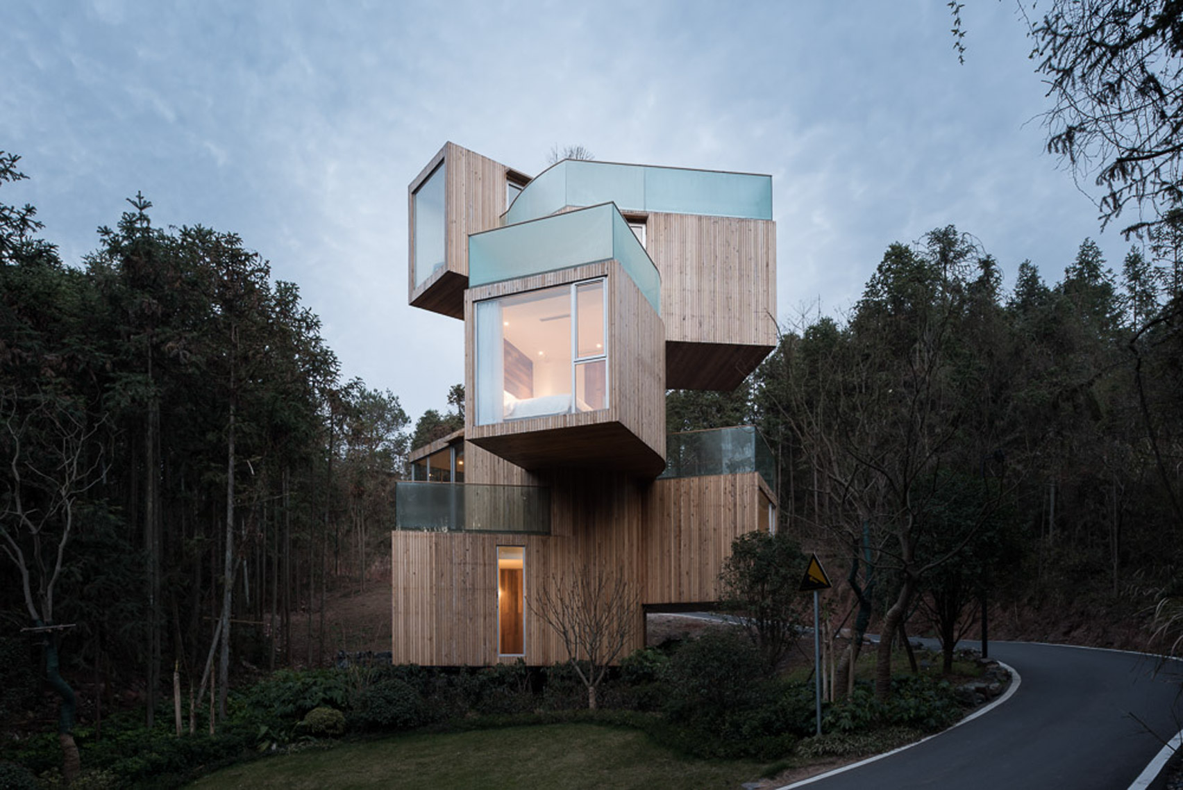 Stacked boxes form Bengo Studio's towering Tree House hotel in rural China