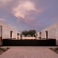 Limestone walls define sequence of courtyards at Arizona desert home by Marwan Al-Sayed
