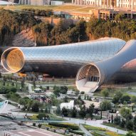 Conjoined glass and steel tubes form Studio Fuksas' concert and exhibition venue in Tbilisi