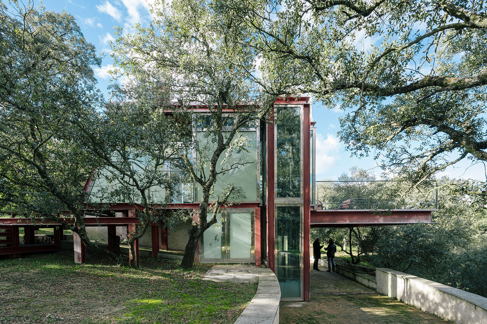 Penelas Architects embeds glass and rusted-steel retreat in forest glade near Madrid