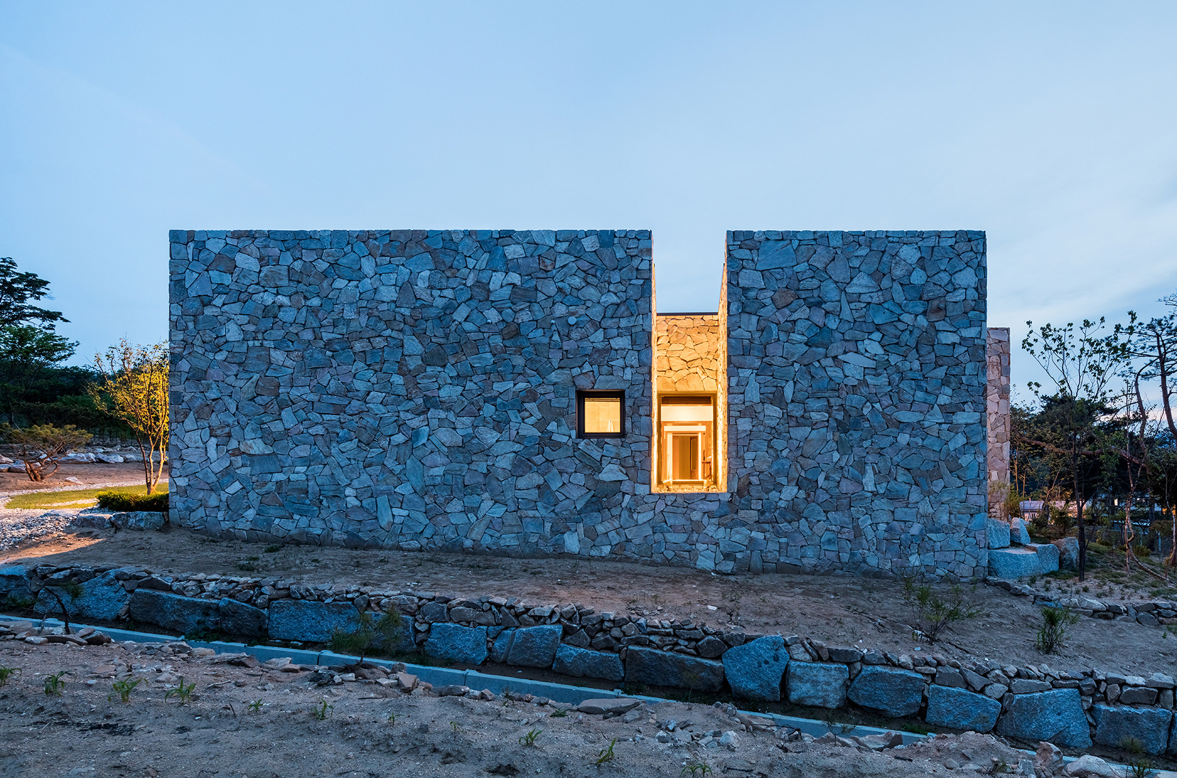 OBBA designs stone-walled holiday bungalow in rural Seoul for an elderly couple