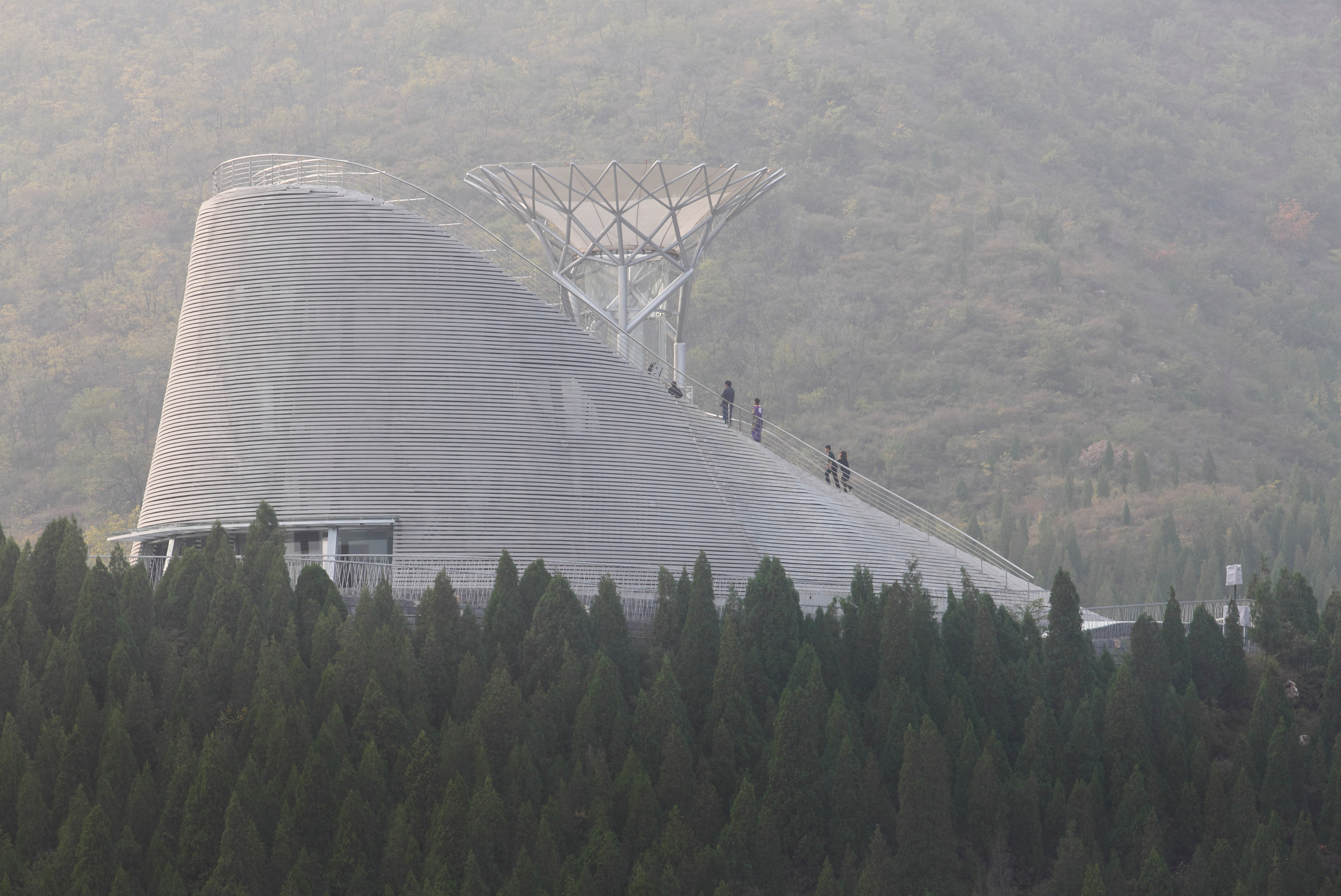 Wind tunnel allows monks to fly above Mailītis Architects' amphitheatre in rural China