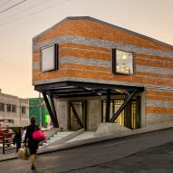 Arqmov Workshop converts Mexico City auto shop into retail centre with patterned facade