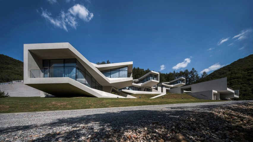 Concrete volumes cantilever and twist to provide mountain views from South Korean holiday resort