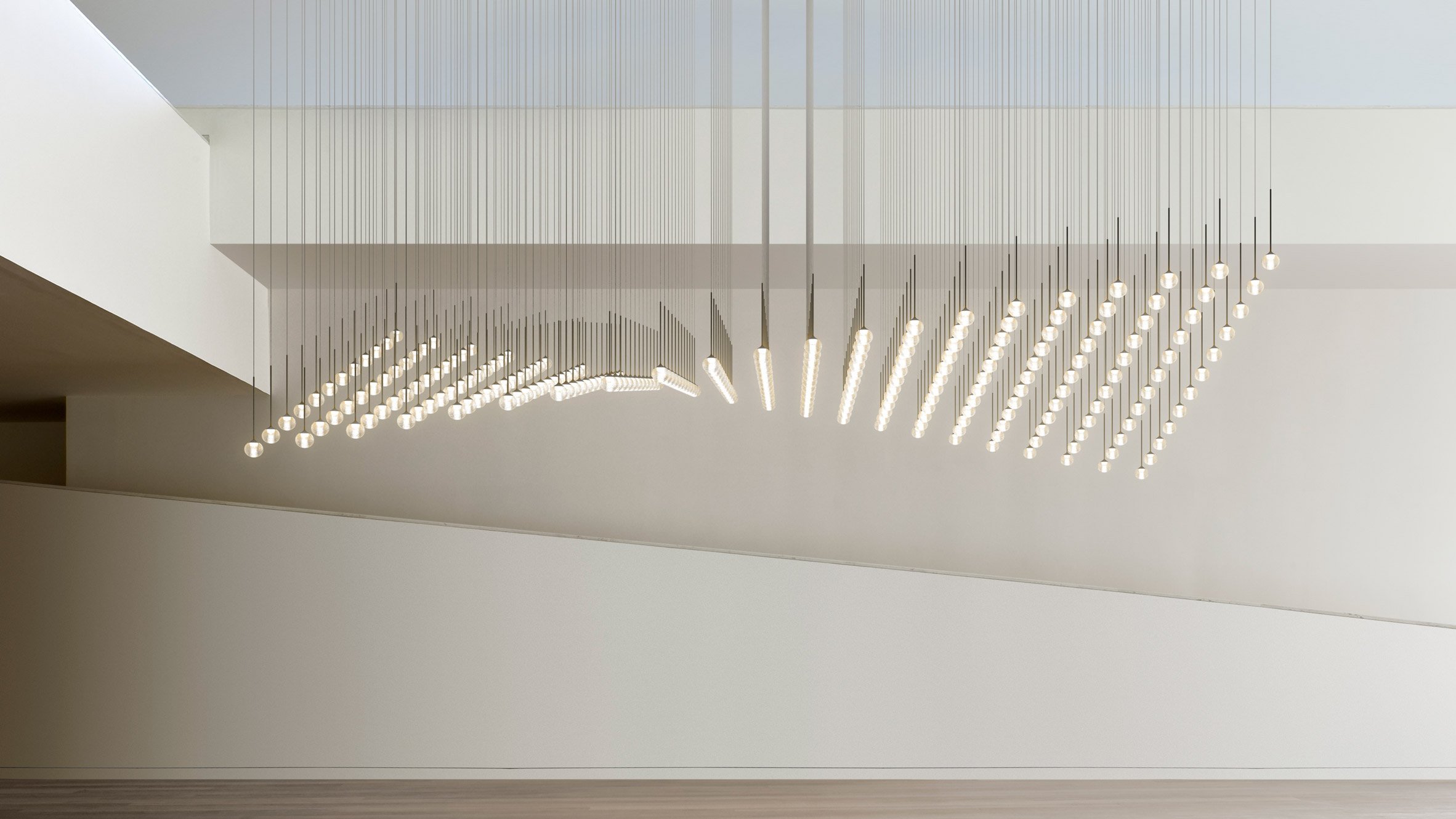 vibia launches customisable lighting system made up of glass spheres -