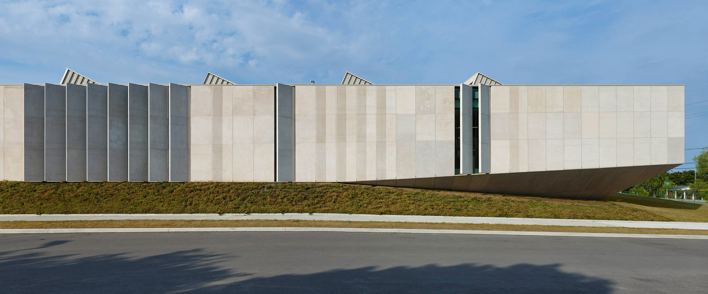 Rdha Embeds Stone And Glass Library Into Grassy Ontario