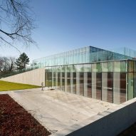 RDHA embeds stone and glass library into grassy Ontario hillside