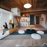 Custom furniture follows lines of geometric graffiti in live-work loft by CHA:COL